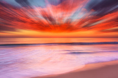 an abstract beach sunset image created using a zoom lens and a longer shutter speed resulting in a very unique photograph
