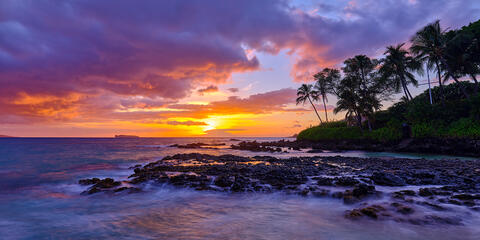 panoramic sunset with purple and violet tones at Secret Beach in Makena on the island of Maui