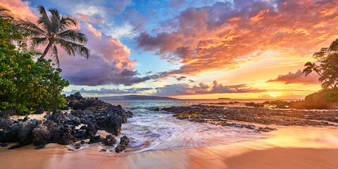 A very special panoramic view of sunset at a very special Secret Beach in Makena on the island of Maui, Hawaii.  Hawaii sunset pictures by Andrew Shoemaker