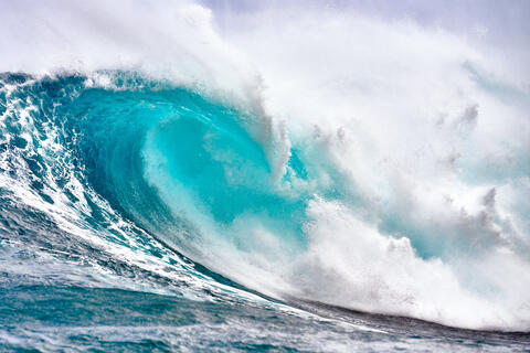 the biggest wave in Hawaii called Jaws crashes in a dramatic photograph by Andrew Shoemaker