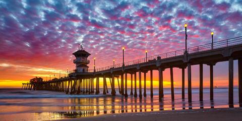 panoramic image of sunset at the beautiful Huntington Beach pier in Huntington Beach, California