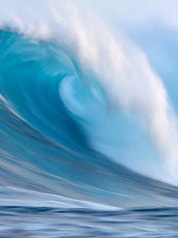 a vertical long exposure photograph of the biggest wave in Hawaii Jaws on the north shore of the island of Maui.