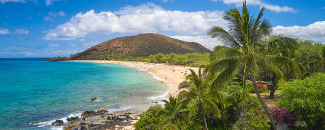 panorama of makena state park on the island of Maui with crystal clear Hawaiian water and coconut palms.  Fine art photography by Hawaii artist Andrew Shoemaker
