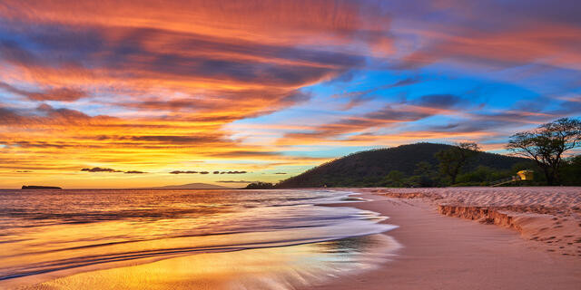 A glorious sunset erupts for this panoramic view of Big Beach (Makena State Park). The sky resembles almost a mirror of the beach itself for this special image