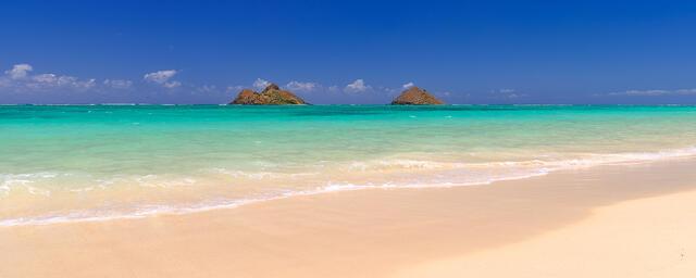 panorama print of the beautiful Lanikai Beach on the Hawaiian Island of Oahu.  Blue sky, amazing water color and the Mokolua Islands on the horizon