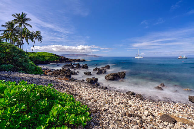 a daytime scene of a white coral beach in south maui.  Photographed by Andrew Shoemaker
