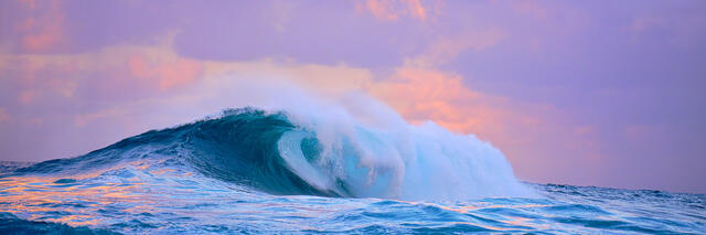 panorama sunset at Jaws (Peahi) on Maui with nice pastel tones as the biggest wave in Hawaii crashes