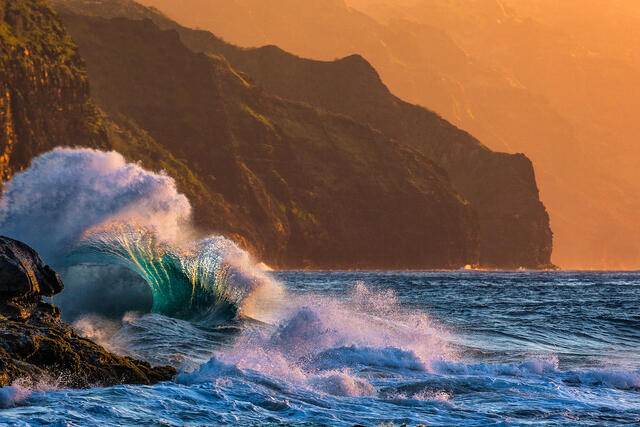 Waves collide along the Na Pali Coastline at Ke'e Beach at sunset and make some very interesting patterns