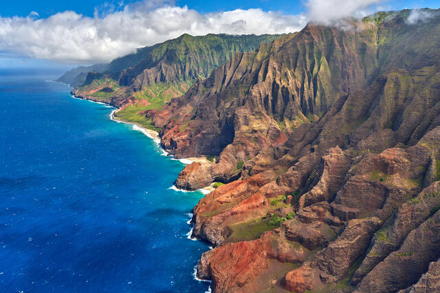 a very dramatic angle of the na pali coastline on the Hawaiian Island of Kauai.  Photographed from a helicopter by Andrew Shoemaker