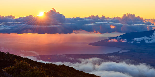 the view looking down on the western slope of Maui from on top of Haleakala Summit at Haleakala National Park on the island of Maui