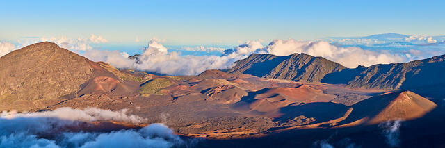 panoramic view of Haleakala Crater during the daylight.  The big island of Hawaii can be seen in the distance.  Photographed by Andrew Shoemaker