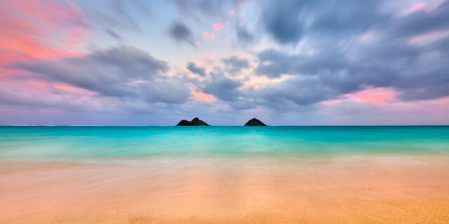 A long exposure panoramic photograph captured at the beautiful Lanikai Beach on the island of Oahu.  Pastel colors at sunset here make this photograph special