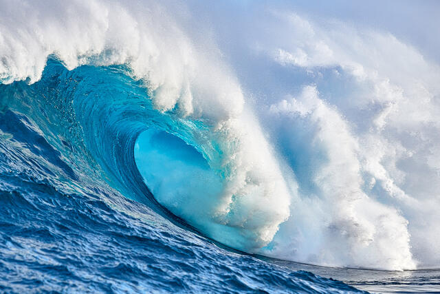 aqua blue water right down the barrel at the largest wave in the Hawaiian islands Jaws or Peahi on the island of Maui