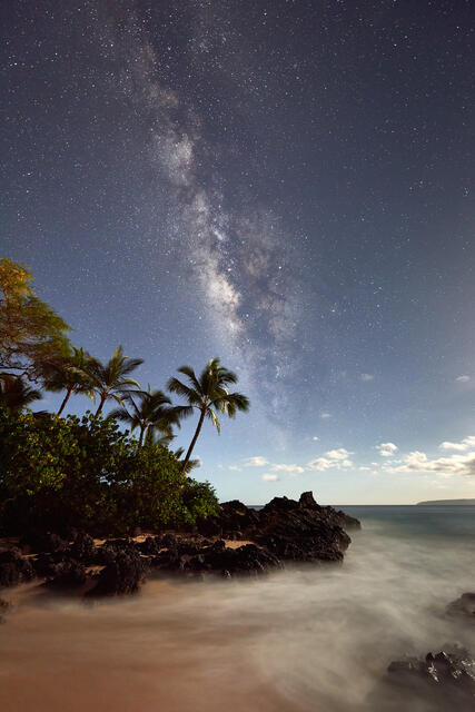 The Milky Way Galaxy rises over Secret Beach in Makena on the island of Maui.  The moon low on the horizon provides lighting for the foregound.  MIlky Way Photo