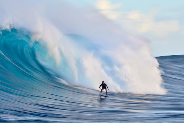 a slow motion capture of surfer Kai Lenny surfing Jaws on Maui