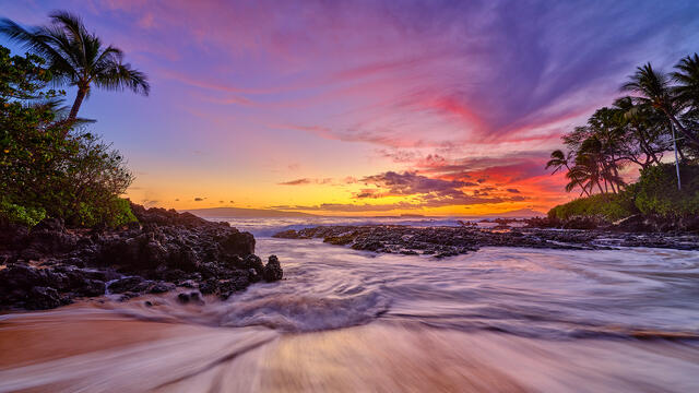 pink, purple and magenta sunset panoramic photograph at secret beach in Makena on the island of Maui