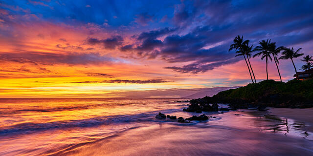 a very vibrant sunset panoramic photograph at Polo Beach in Wailea on the island of Maui.  Maui Landscape Photography by Andrew Shoemaker
