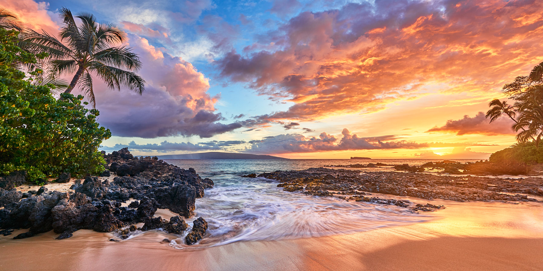 A very special panoramic view of sunset at a very special Secret Beach in Makena on the island of Maui, Hawaii