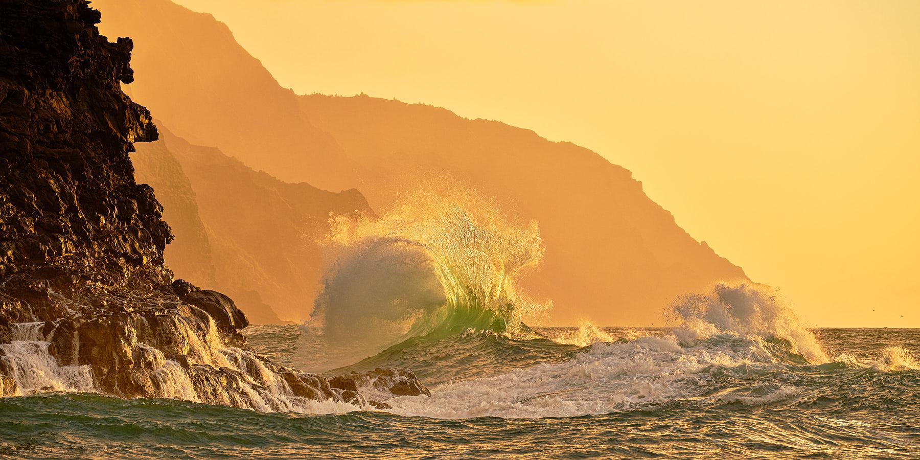 big waves collide along the Na Pali Coast of Kauai sunset