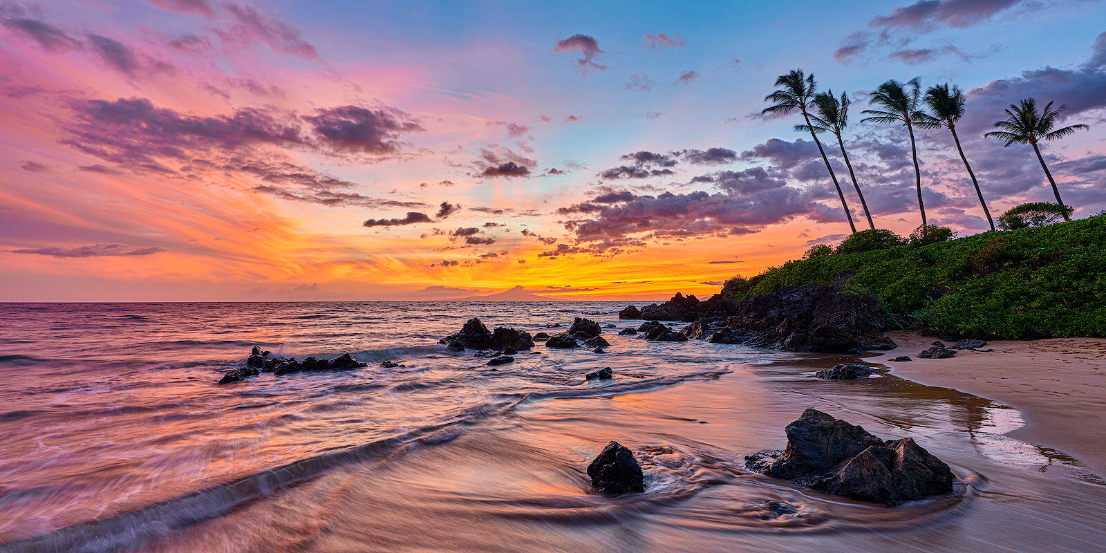 a panoramic sunset with lovely pastel colors and water movement from the ocean at Polo Beach on the island of Maui.  Fine art photograph by Andrew Shoemaker