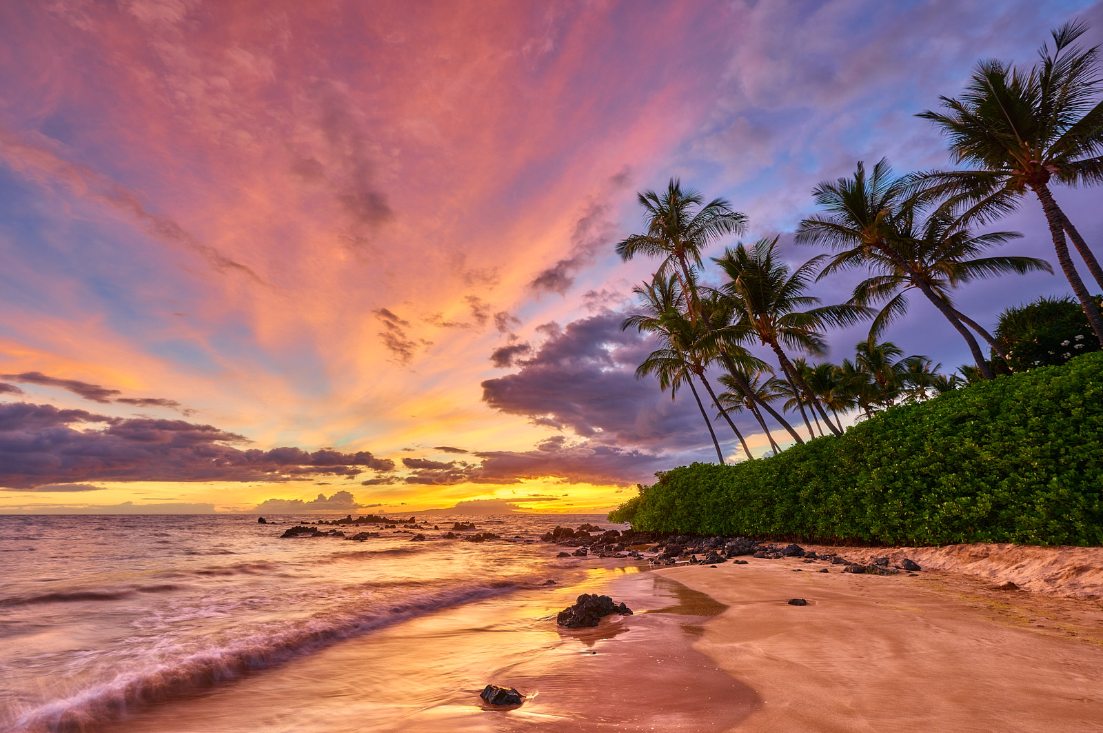 Another classic south Maui sunset at White Rock (Palauea) in Wailea highlighted by vibrant pink and purple colors