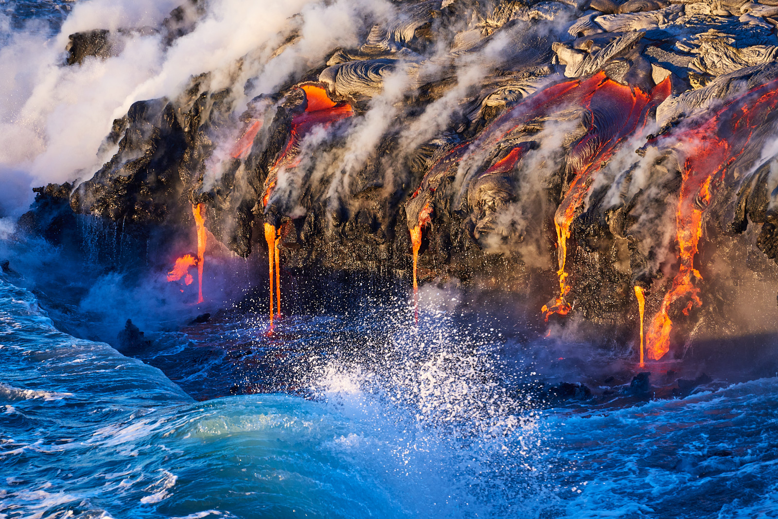 lava ocean entry photography at sunrise on the Big Island of Hawaii in Volcanoes National Park