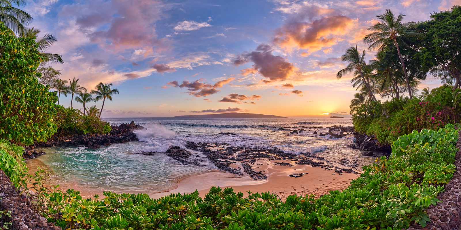 panorama of the beautiful Secret Beach in Makena on the island of Maui at sunset