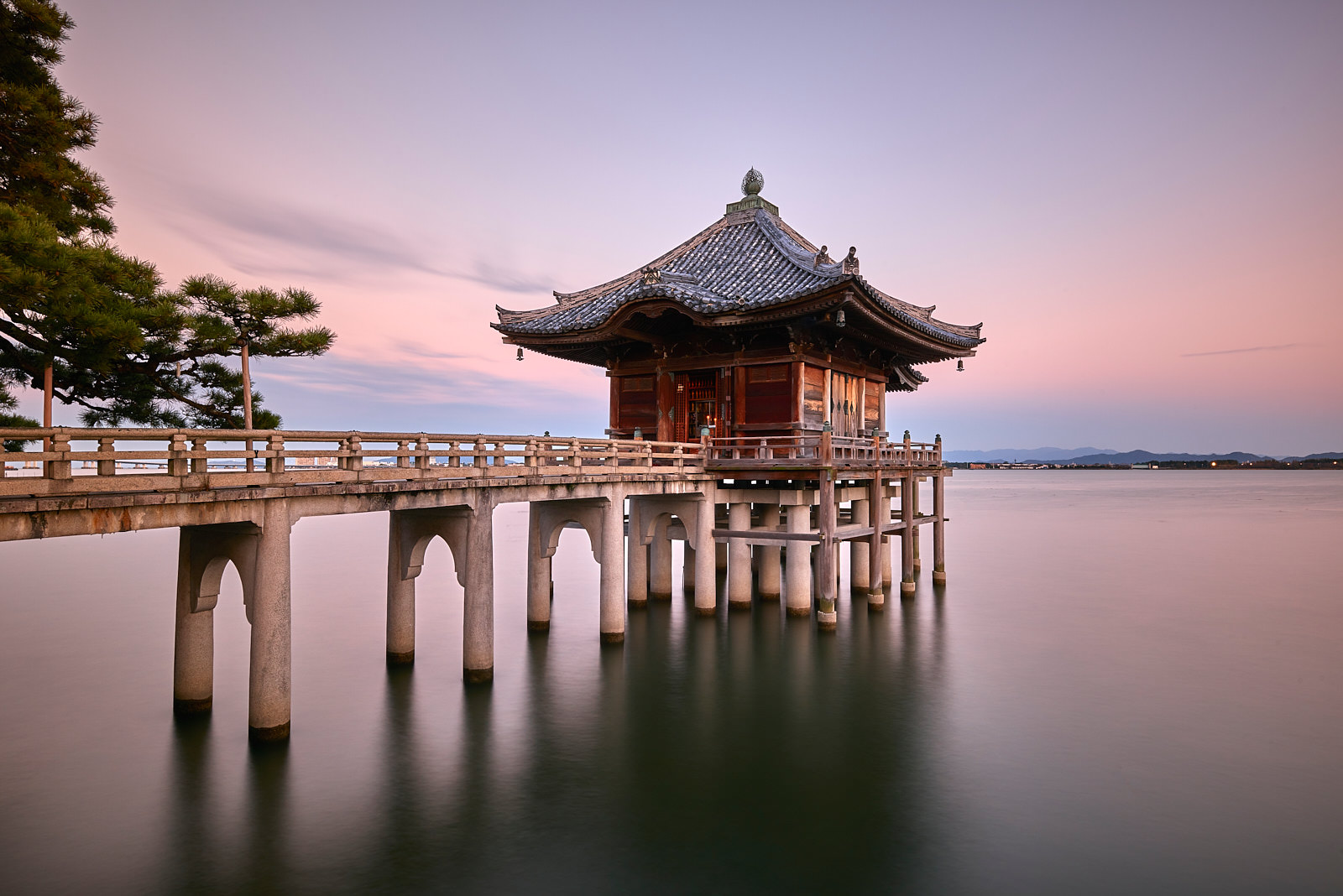 a long exposure of a floating temple with a bridge going out to at Ukimodo temple in Kyoto, Japan