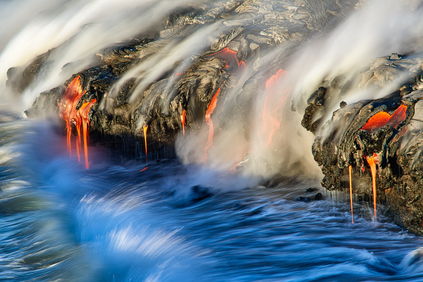 lava meets the ocean just after sunrise at the 61G lava flow on the Big Island of Hawaii